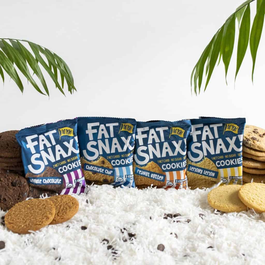 Individual package of all four Fat Snax cookies with a bedding of coconut and chocolate chips
