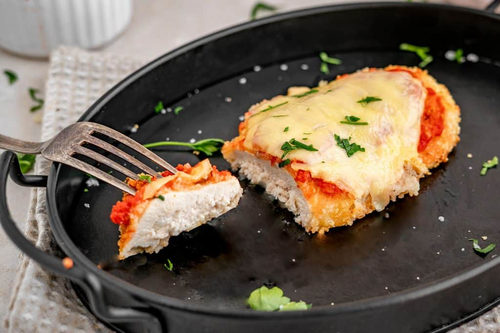 finished keto chicken parmesan recipe with a bite taken out