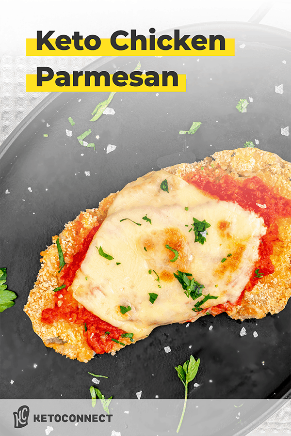 keto chicken parmesan on a black plate with garnish