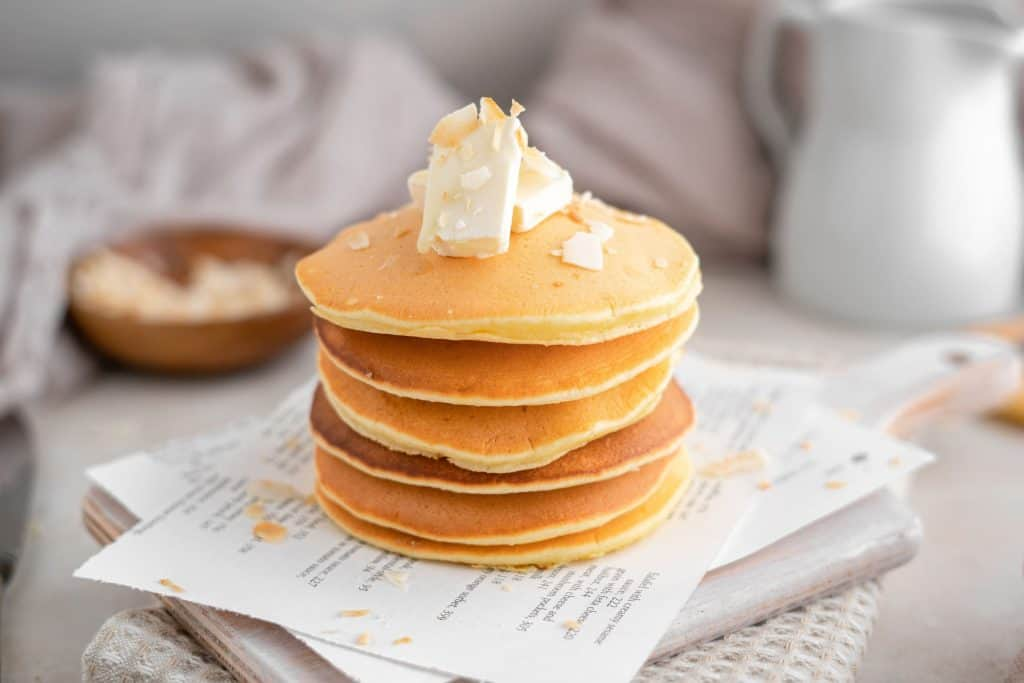 Six protein pancakes atop a cutting board