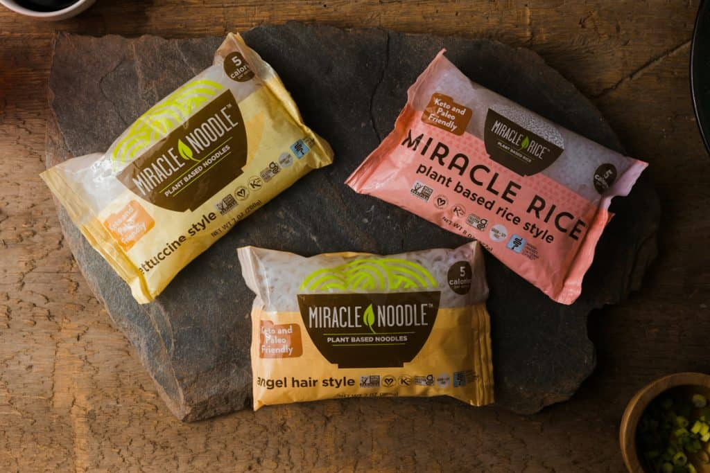 Packages of Miracle noodles on a stone backdrop