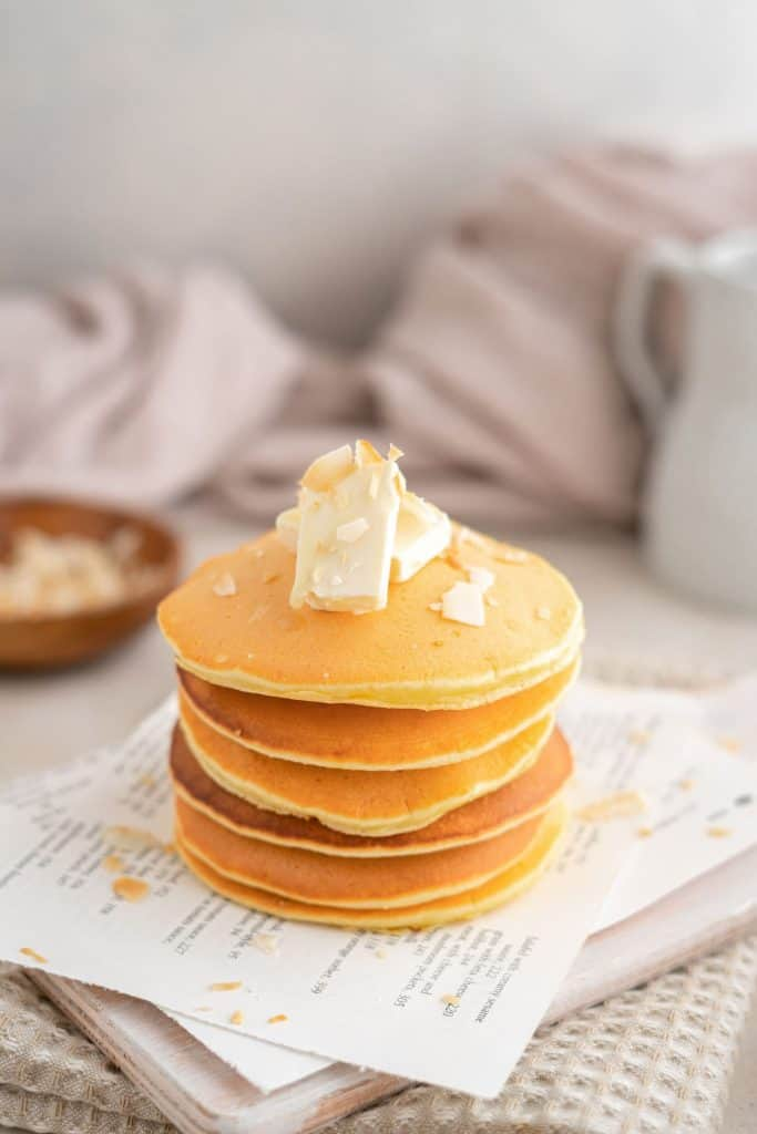 fluffy pancakes stacked with butter