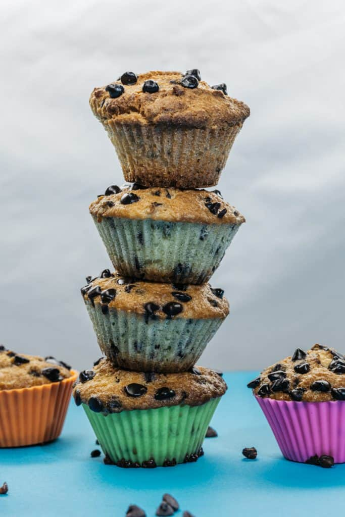 A tower of almond flour muffins in bright silicone muffin liners