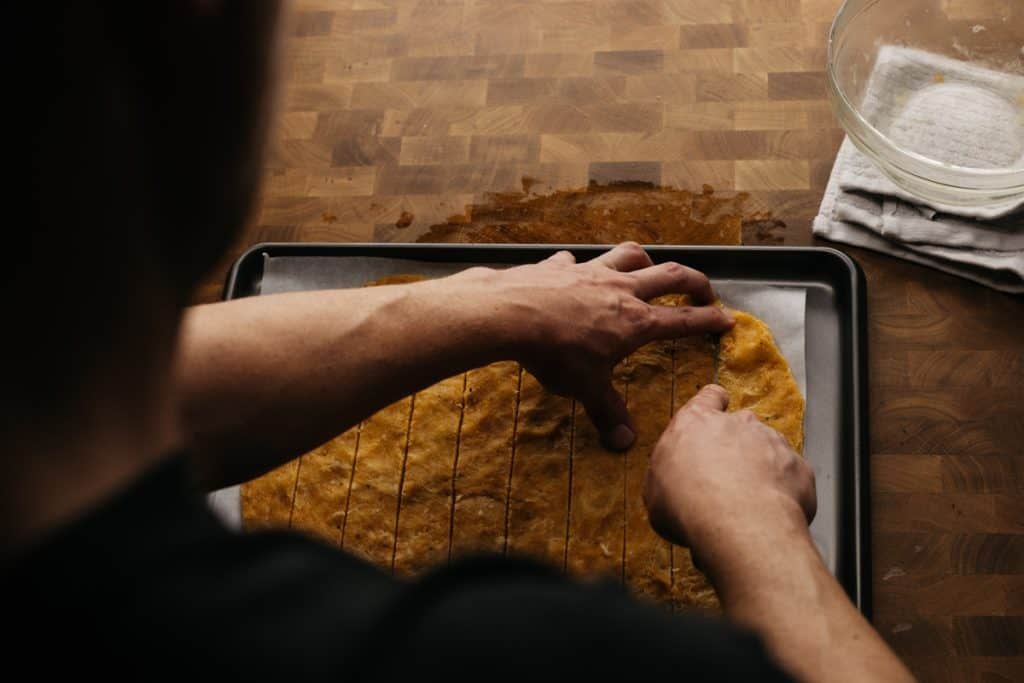 Cutting keto tortilla chips over the chefs shoulder