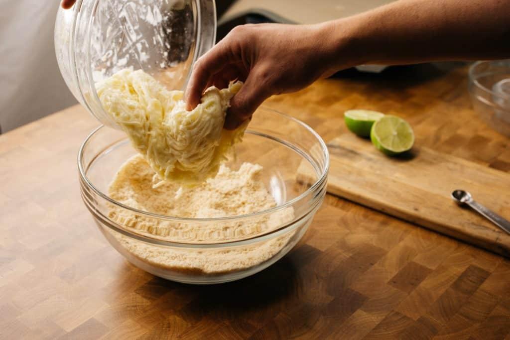Adding melted mozzarella to the flour base