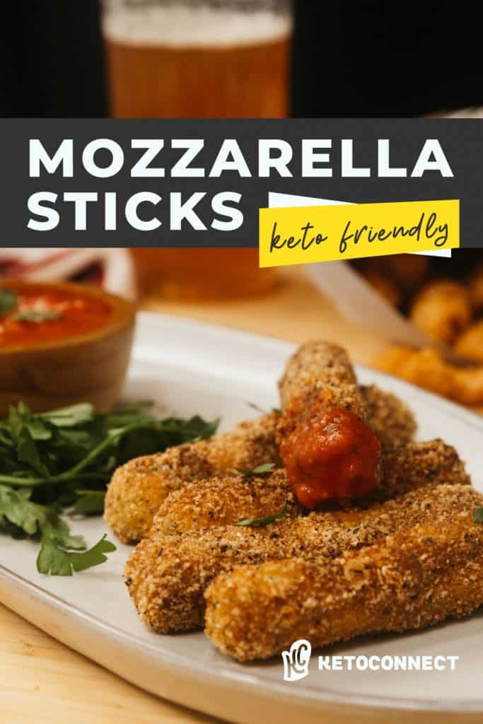 mozzarella sticks on a plate with a beer in the background