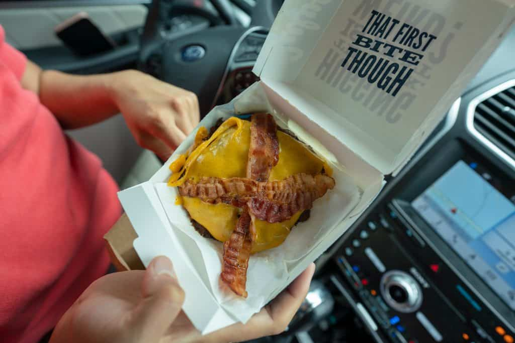 double bacon butterburger from culvers in a to go box
