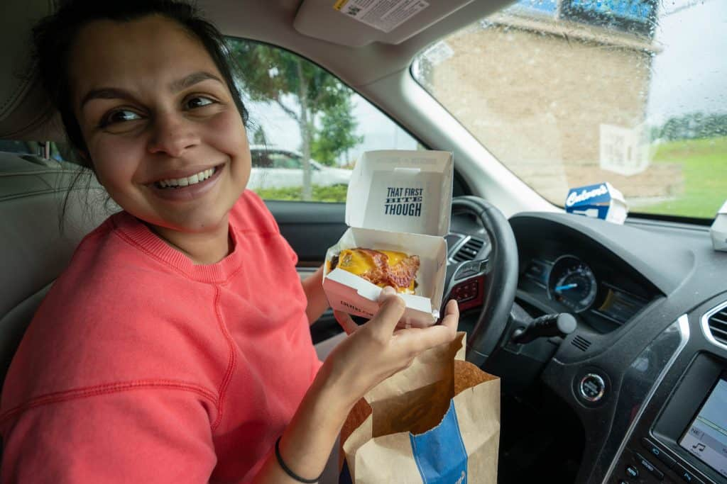 holding a keto culvers bunless butterburger in the drive thru