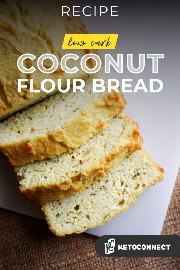 coconut flour bread sliced on a cutting board with rosemary