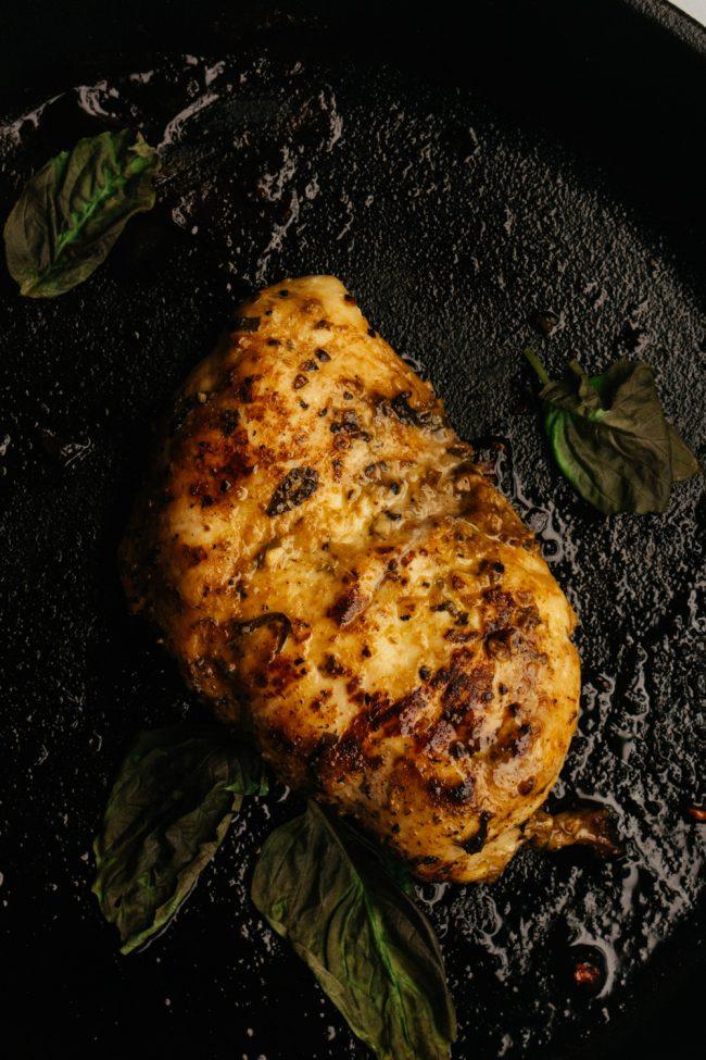 basil pesto keto chicken marinade being cooked