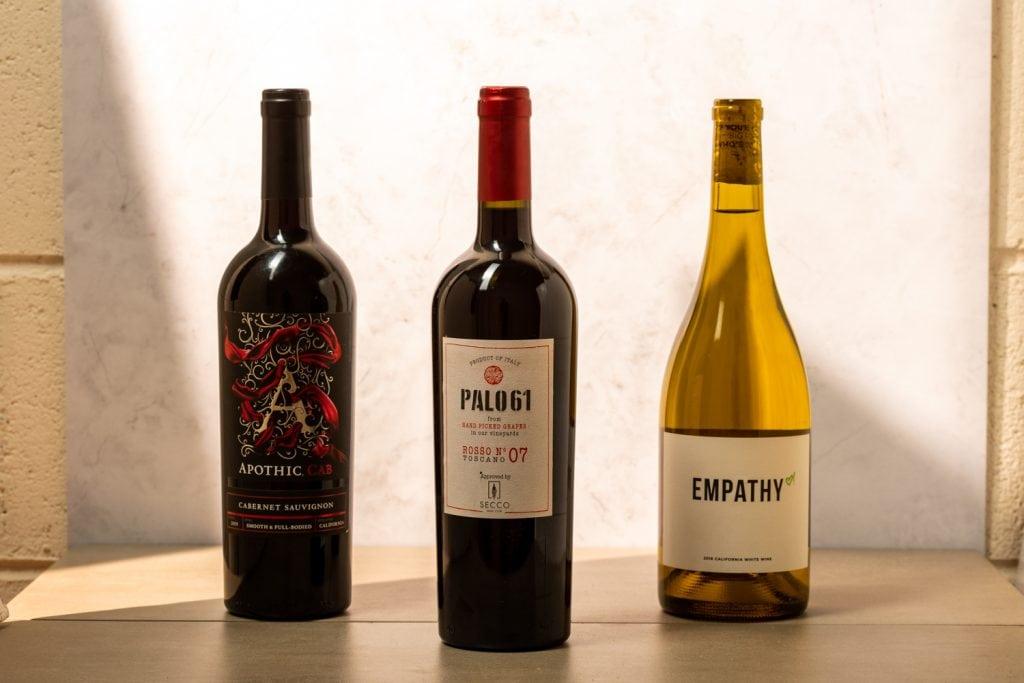 three keto wine bottles on a table