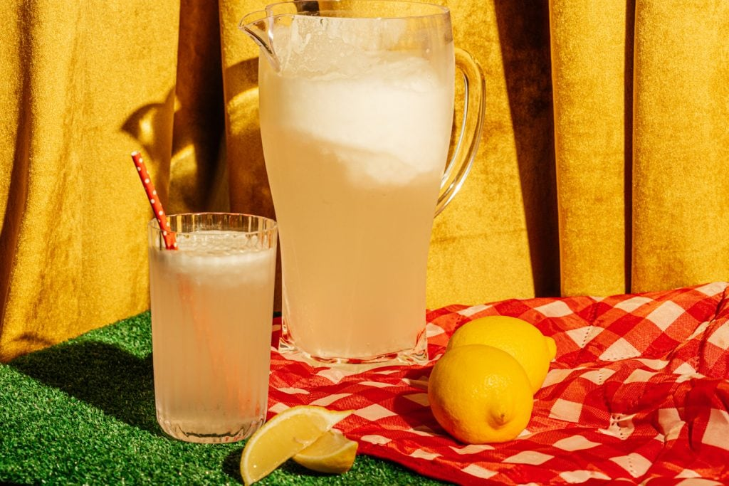 pitcher of sugar free lemonade and a glass on a table