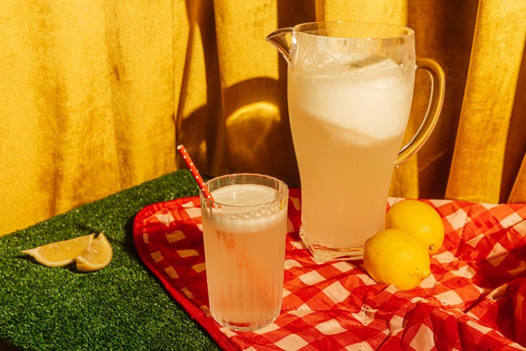pitcher of sugar free lemonade on a picnic table