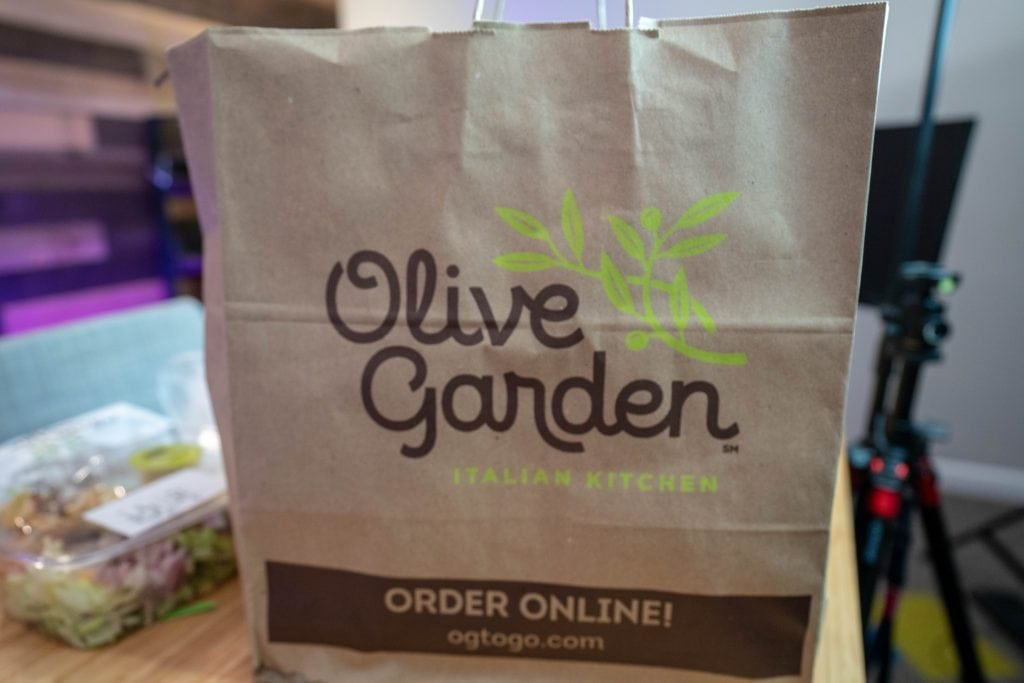 olive garden to go bag sitting on a table