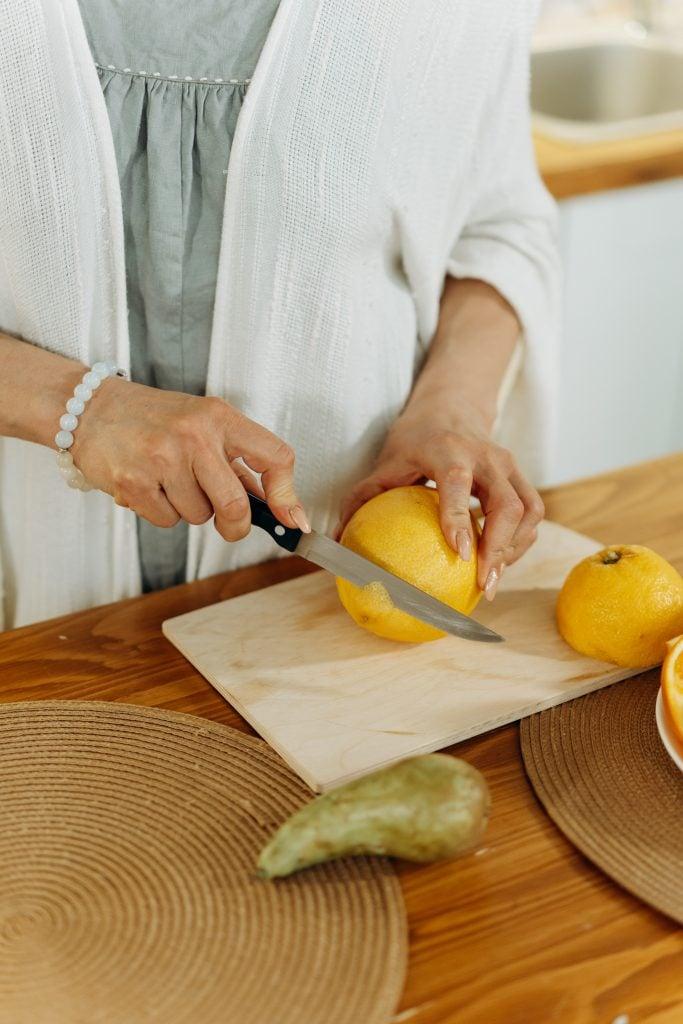 older woman cutting lemons