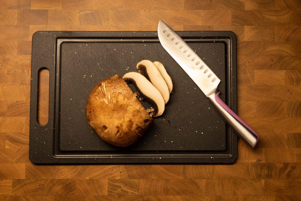 a portabella mushroom being chopped