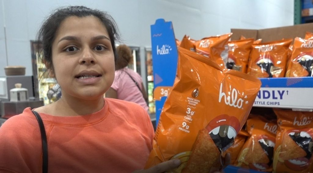 woman holding hilo life keto chips at costco