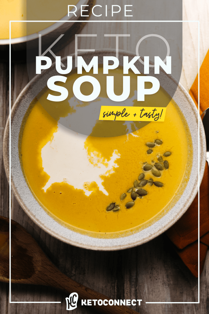a large bowl of keto pumpkin soup with pumpkin seeds on top