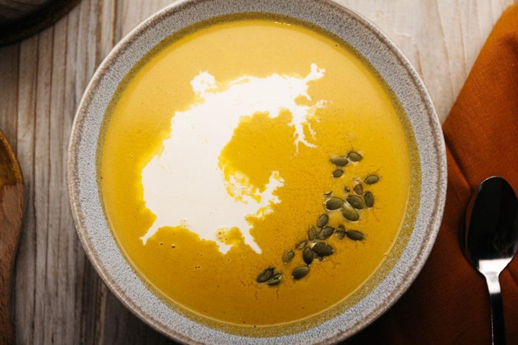 overhead shot of keto pumpkin soup in a bowl