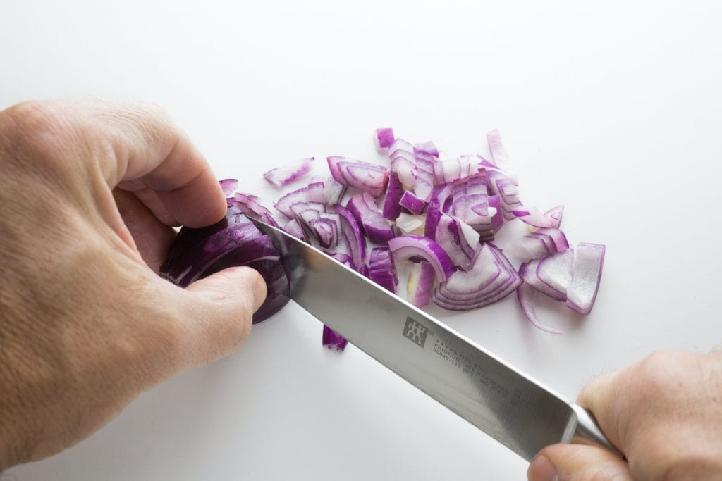 chopping a shallot for cooking