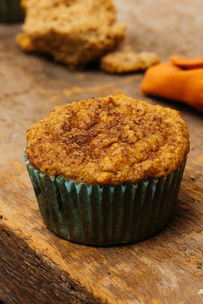 a single pumpkin muffin on a cutting board