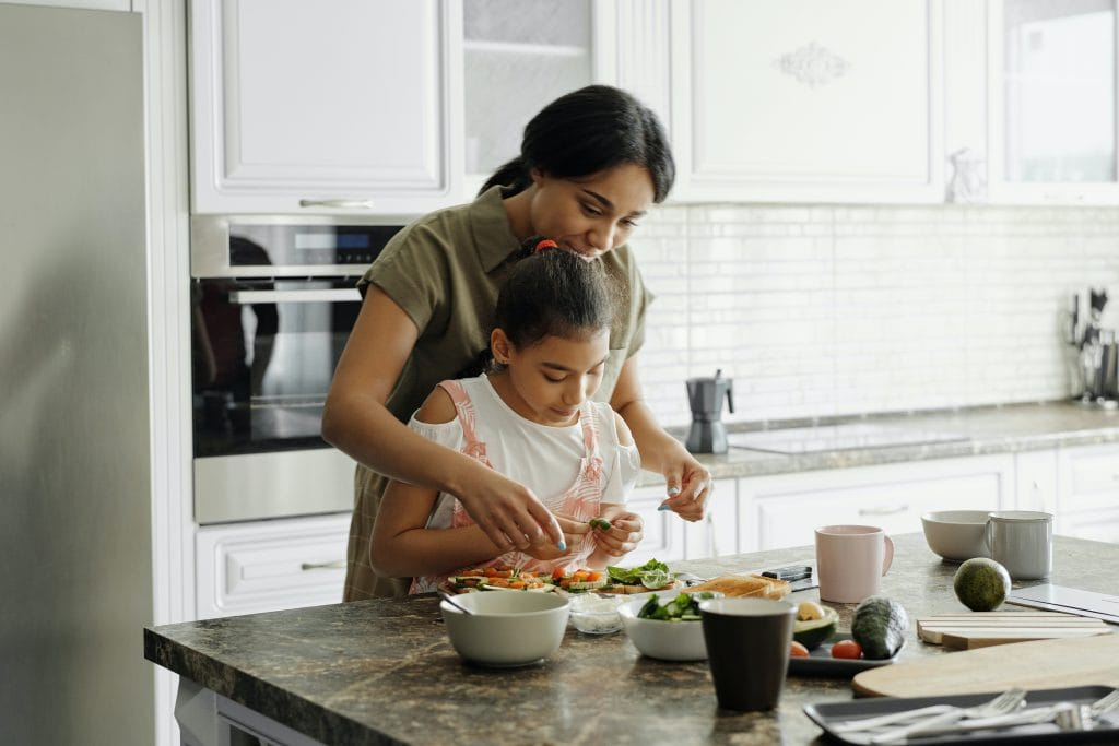 woman and daughter cooking in the kitchen