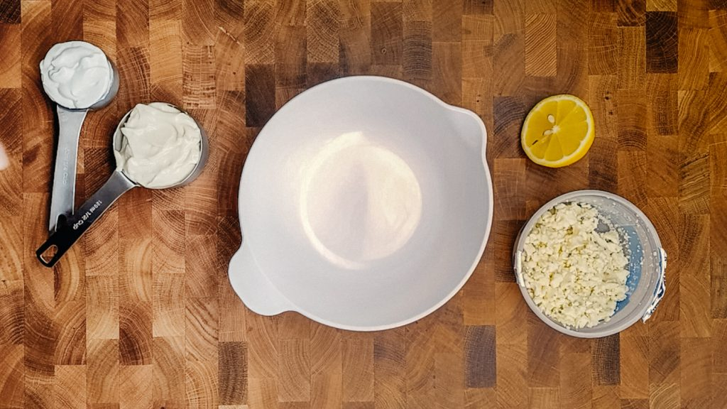 keto blue cheese dressing ingredients on a cutting board