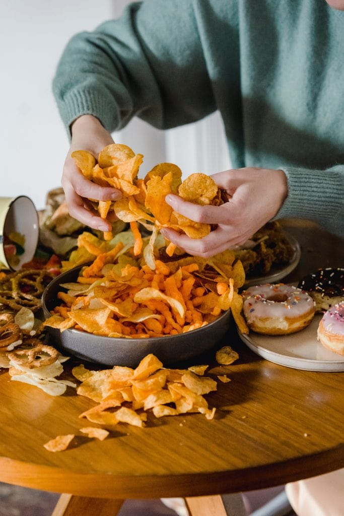 large pile of chips and pretzels