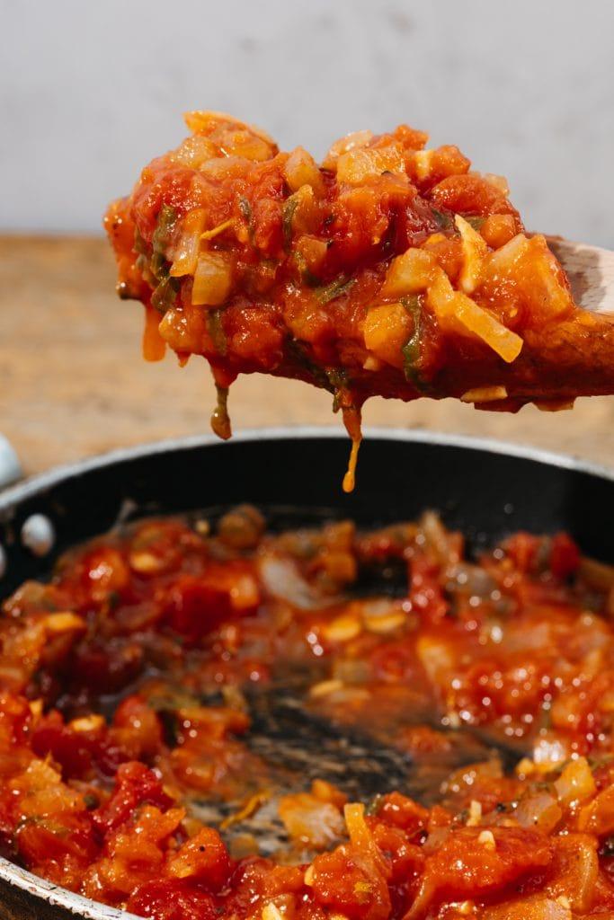 keto spaghetti sauce on a wooden spoon